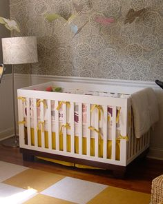 whimsical wallpaper, yellow & white block rug and modern crib #HearTones #babyroomideas