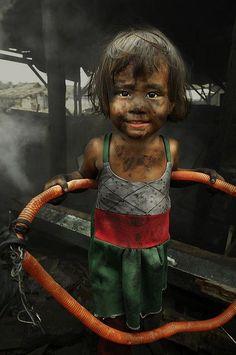 Little girl in Manila , playing the hula hoop.