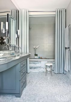 Color, Ceiling height shower curtain(s), mirror wall with mirrors on it and subway tile on back wall