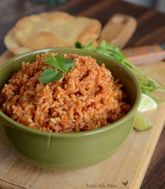Easy Spanish Rice in the Rice Cooker with brown rice.  Increased the water by 1cup and used my electric pressure cooker for 15 minutes!  Perfect! I added another can of diced tomatoes after it was cook.