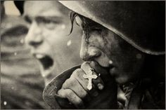 A Russian soldier prays before the Battle of Kursk, July 1943.