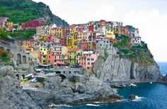 CINQUE TERRE, Italy: is a very jagged, steep coastline, which the work of humans over the millennia has transformed into an intensively terraced landscape so as to be able to wrest from nature a few hectares of land suitable for agriculture, such as growing vines and olive trees.  The cultivation terraces that typify much of the Cinque Terre landscape were mainly built in the 12th century.