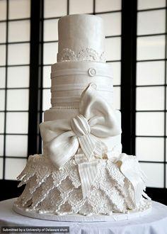"Elegant white wedding cake designed by UD alum Dana Herbert, CHEP '98, owner of Desserts by Dana and winner of TLC's ""Next Great Baker."" @Jenna Specht woah."