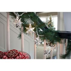 Sparkling silver snowflake string lights top off your holiday decor