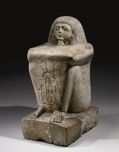 AN EGYPTIAN LIMESTONE BLOCK STATUE OF THE TRANSPORT OFFICIAL KARO, 20TH DYNASTY, REIGN OF RAMESSES III, 1187 - 1156 B.C.