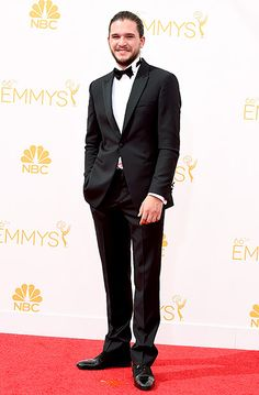 Kit Harrington looked sleek in a one-button tuxedo by Emporio Armani with a Bulgari Bulgari watch and Octo cuff links at the 2014 Emmys. (And he rocked an amazing man bun!)