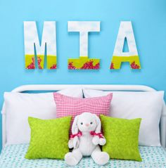 "Create customized wall art for your child's bedroom with our canvas-coated wooden letters. Whether you decorate their first initial, their full name or a fun phrase such as ""Sweet Dreams"", these letters will definitely spell out adorable."