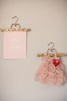 Adding sequin to regular child's clothes hanger and using them to display special items in the room as decor