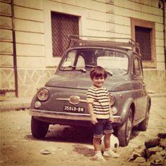 A little boy and a Fiat 500.