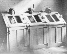 Patients in steam cabinets, c 1910. American Psychiatric Association Archives