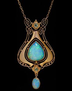 MURRLE BENNETT & Co. (1896-1914)   A gold pendant set with a large central opal surrounded by wirework motifs set two peridots and with an opal drop