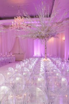 The clear chairs really add a modern touch to a wonderful winter wedding