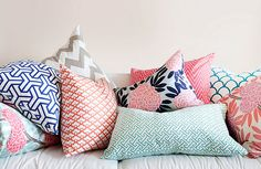 Coral, navy, aqua. This is the color palet I have been trying to set up in my living room. Loooove these pillows!