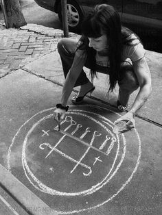 Mimi, a witch who owns Esoterica Occult Goods in New Orleans drawing a sigil, April 14, 2007 // Craig Morse