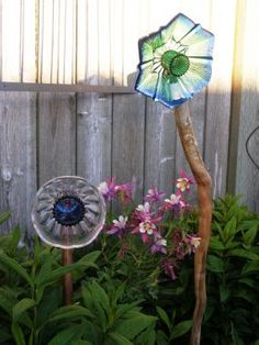 Garden Flowers made out of glass bowls, candle holders, ashtrays, plates, knobs, tins anything that can transform into a flower.