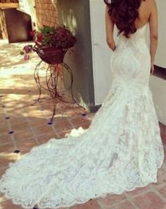 Love the lace train For more bridal inspiration visit us at Lola Bee and me