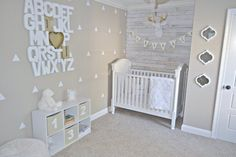 Alphabet wall art and white washed pallet accent wall in McKenzie's nursery