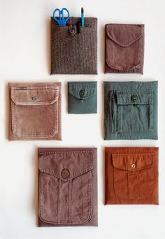 Recycled Wall Pockets via Cuarto derecha  Modern take on the traditional recycled wall pockets. Use dollar store canvases, a staple gun and some pockets from old clothing. Love this idea.