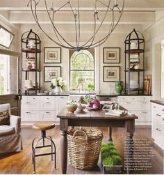 Great looking kitchen, love the armchairs and center island that can be used as a table.