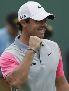 Rory McIlroy celebrates on the 18th green.