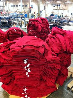 Gigantic stack of red sweatshirts staged at a press.  www.visualimp.com