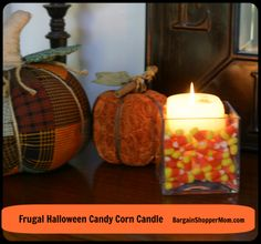 Make your own Halloween candy corn candle for under 1 dollar.