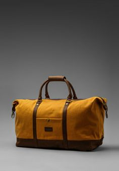 OBEY Uptown Duffle in Inca Gold at Revolve Clothing
