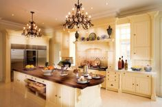 Victoria Design Kitchen, plus chandeliers. vewy noice