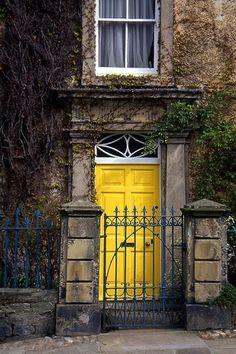 Bright yellow door . . . love the sunshine feel of it.