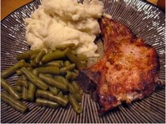 """Crockpot Pork Chops-These we're super yummy! In fact Mike startled me at dinner after he took a bite and exclaimed""""this is so good!"""" a little louder than i was expecting him to. So easy and I will definitely make again. I used a little more butter than the recipe calls for and I added in some garlic herb seasoning."""