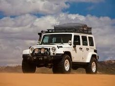 Google Image Result for http://www.lincah.com/wp-content/uploads/2009/11/2009-Jeep-Wrangler-Overland-Front-Side-View.jpg