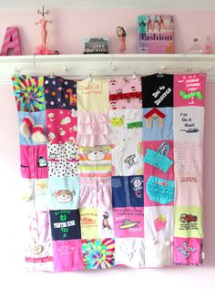 quilt made of baby's clothes...sweet idea...