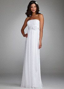 Feel like a goddess in this ethereal soft chiffon style.  Ruched waist is slimming and flattering while cluster of oversized flowers add a feminine touch.  Floor-length skirt features romantic side drape that is both fashionable and flattering.  Fully lined. Invisible back zipper. Imported polyester. Dry clean only.  Available in White. To protect your dress, try our Non Woven Garment Bag.