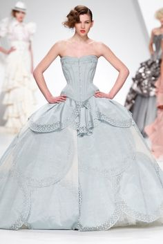 For corsets and gowns, storytailors is amazing!  http://www.storytailors.pt/