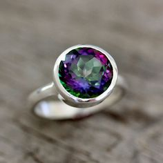 Omg this ring is like the 80s in a good way. Limited Edition Sterling Silver Ring Featuring Mystic Topaz Ring, Recycled Sterling ROCK FETISH. $168.00, via Etsy.