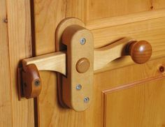 This hand made door latch is unique and interesting.  There are other types shown on the site at http://woodgears.ca/wood_hardware/doorknobs.html , but for some reason I could not pin from the link.