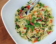 Asian Slaw with sugar snap peas and an Asian dressing. Lots of color and crunch. WW friendly, low carb.