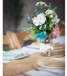 #DIY Burlap Mason Jar Wedding Centerpiece | Click through to Joann.com for How-to Directions | Supplies available at Joann.com and Jo-Ann Fabric and Craft Stores | #craftyeverafter