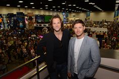 SUPERNATURAL stars Jared Padalecki (left) and Jensen Ackles look out from the Warner Bros. booth at Comic-Con 2012 (© WBEI. All Rights Reserved.)