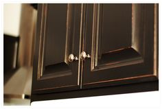 kitchen cabinet DIY tute -- love the layered result of red peaking through the black ----