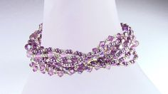February's Birthstone is Amethyst.  I used 5 different Amethyst crystals and Miyuki's new Duracoat Rocailles to create this multistrand bracelet.  This two part YouTube Video shows how to make it:    http://youtu.be/YimkMgfzpDo    http://youtu.be/2vJRNl72HMc