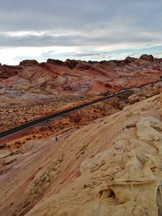 Gorgeous layers of colored sandstone in Valley Of Fire State Park - Such grandeur,see my tiny wife hiking down there. - http://www.loveyourrv.com/visit-to-valley-of-fire-state-park-nevada/ #RV #Trip #Nevada