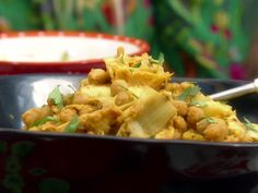 Chickpea and Artichoke Masala from Aarti Sequeira, 4 of 5 Stars 65 Reviews.  Note:  Uses Roma tomatoes, yogurt and lime.