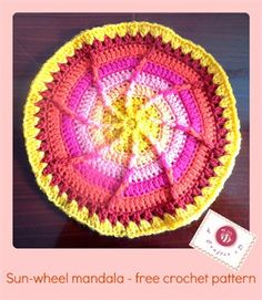 This crochet home decor project is fun and colorful. Sun wheel mandala - Media - Crochet Me