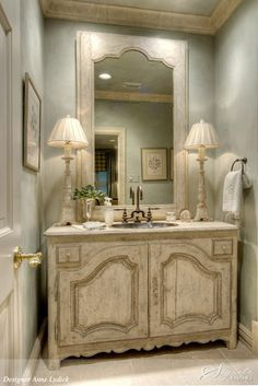 """A particularly lovely French inspired powder room/ bath #vanity sink. Note: """"I have sold several sideboards  cabinets that interior designers, builders  clients have happily adapted as unique bath vanities. These pieces look more beautiful, often cost less than stock or custom cabinets while adding  interesting charm  value to your home."""" Carolyn Williams, Antiques  Interiors, Atlanta  Roswell, GA"""