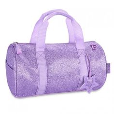 "This purple sparkalicious handbag duffle is the perfect accessory for storing your little girls' everyday essentials!  Features 2 exterior side pockets and 2 interior slip pockets.  Measurements:  11"" wide x 6"" deep x 6.5"" high"
