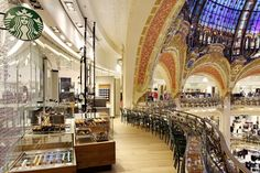 The Starbucks store within Paris' Galeries Lafayette takes its inspiration from the world of fashion that defines the legendary department store. It is crafted with locally sourced wood and black marble, brass, glass, and metal. paris fashion, starbuck store, black marbl
