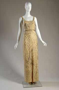 """Embroidered and sequined evening gown by Jeanne Lanvin, French, 1937. Jeanne Lanvin was known for her playful use of embroidery and called this gown her """"carp dress"""" due to the aquatic theme and the large sequined carp at the knee."""