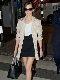 True fashionista Emma Watson stepped out in a simplistically chic ensemble, topped off with demure cat-eye sunnies!