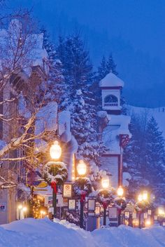 Victorian streetlights on Elk Ave. illuminate Christmas wreaths in Crested Butte, Colorado